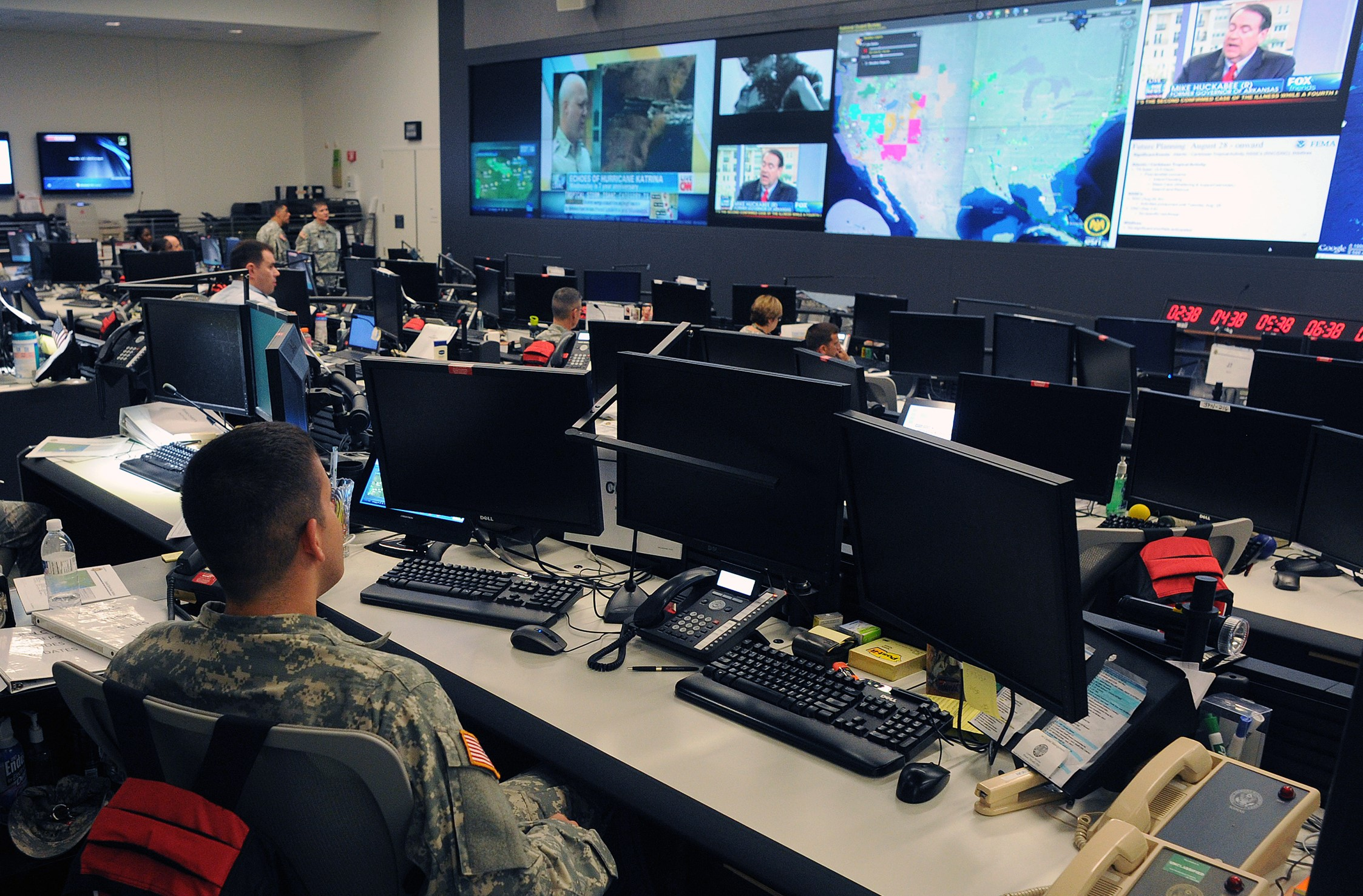 U.S. military personnel in the National Guard Command Center in Arlington, Va., monitor the progress of Hurricane Isaac as it moves through the Gulf of Mexico Aug. 28, 2012. Isaac developed as a tropical storm over the western Atlantic Ocean Aug. 21, 2012, affecting Puerto Rico, the Dominican Republic, Haiti and Cuba before making landfall as a hurricane on the Gulf Coast of the United States. (U.S. Army photo by Sgt. 1st Class Jon Soucy/Released)